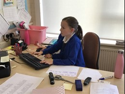 girl at desk typing